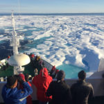 Passengers enjoy the view of the Arctic on an expedition cruise vessel