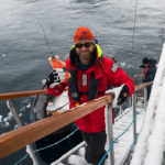 Ari Friedlaender returning aboard after the first successful tagging of a minke whale. Photo: Steve Rose
