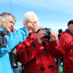 A binocular lesson onboard One Ocean Expeditions vessel in the Canadian Arctic.