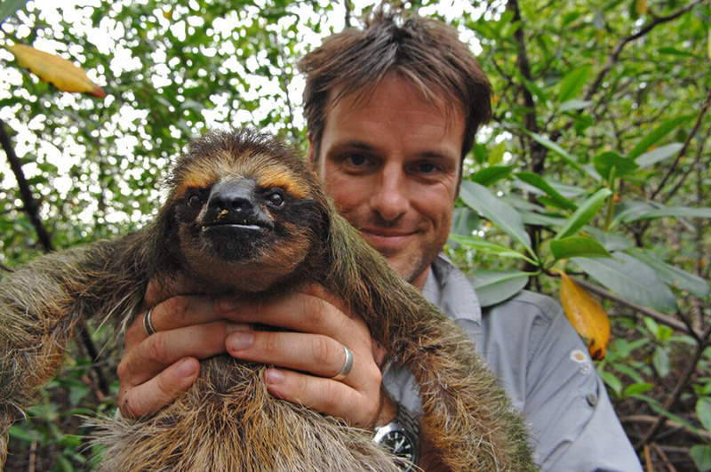 Nick Baker holding a rescued sloth in Central America