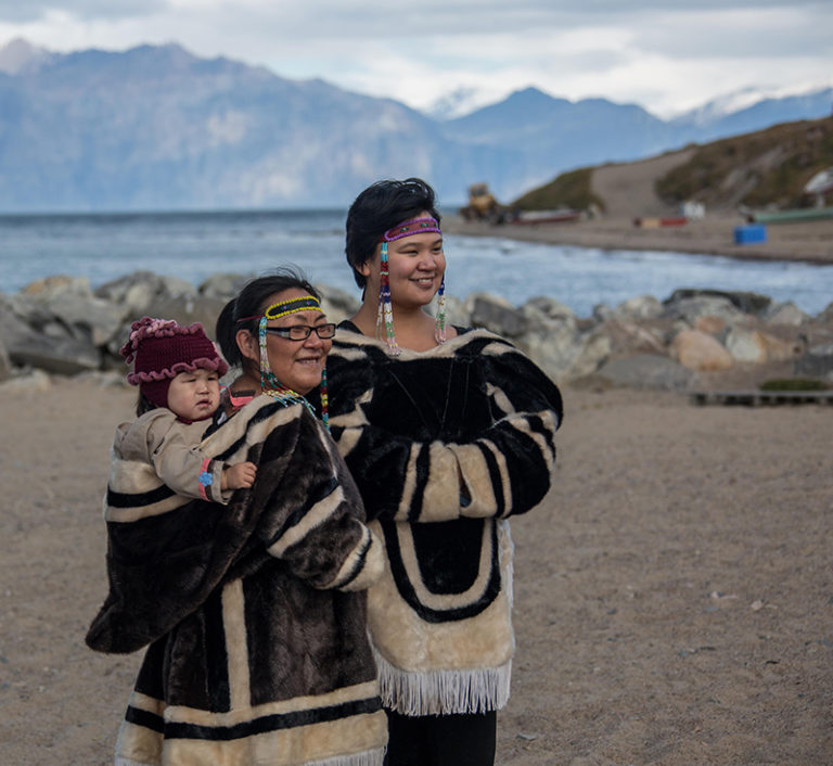 Alex and Rosie welcoming guests to Pond Inlet. Rosie is wearing the tradtional. Photo by Robert Serrini