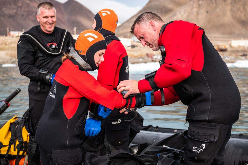 Scuba diver gears up in the Arctic