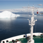Expedition ship is sailing through the northwest passage.