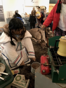 An exhibit at the Pond Inlet museum showing traditional modern hunting and cooking