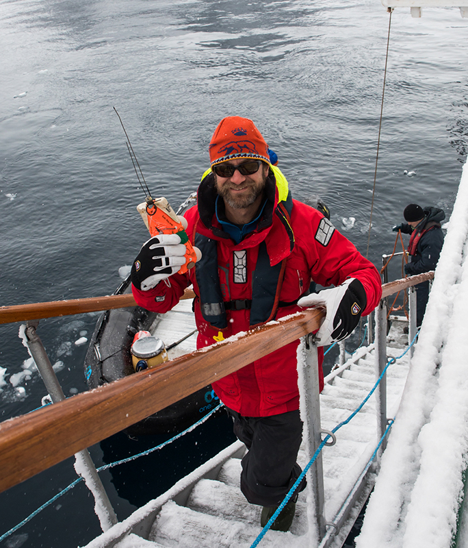 Ari Friedlaender following the first ever tagging of a minke whale. Marine Mammals