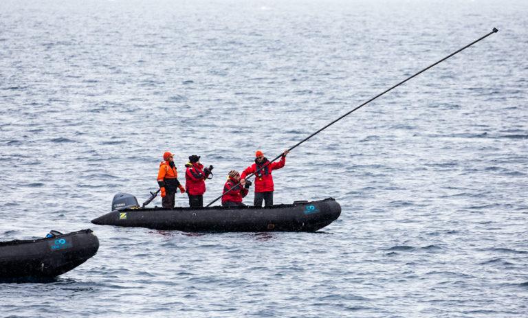 Ari Friedlaender tagging a minke whale on marine mammals. Image Steve Rose