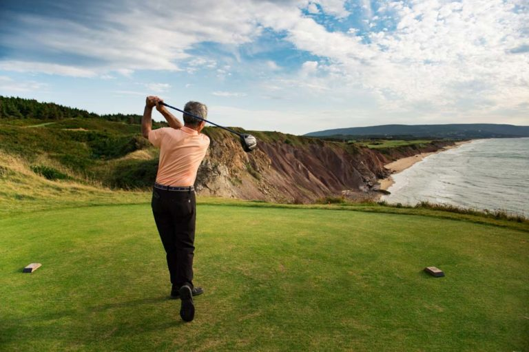 Teeing off from Cabot Cliffs. Photo: Corey Katz